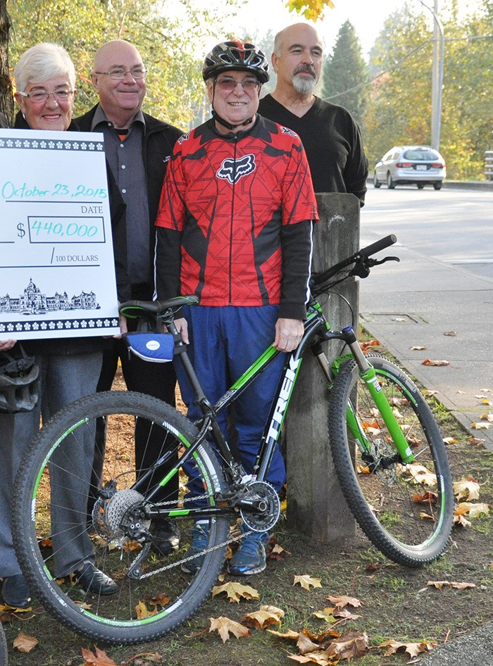 Former City of Langley Councillor Dave Hall stands with his bike during the City's announcement for new bike lanes along 203 Street in October, 2015. Hall passed away Jan. 4 after battling cancer.