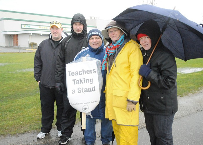 Langley Secondary School teachers rally along 56 Avenue on Monday morning, the first day of a planned three-day strike, which includes a trip to Victoria to join in a larger demonstration at the legislature today (Tuesday).