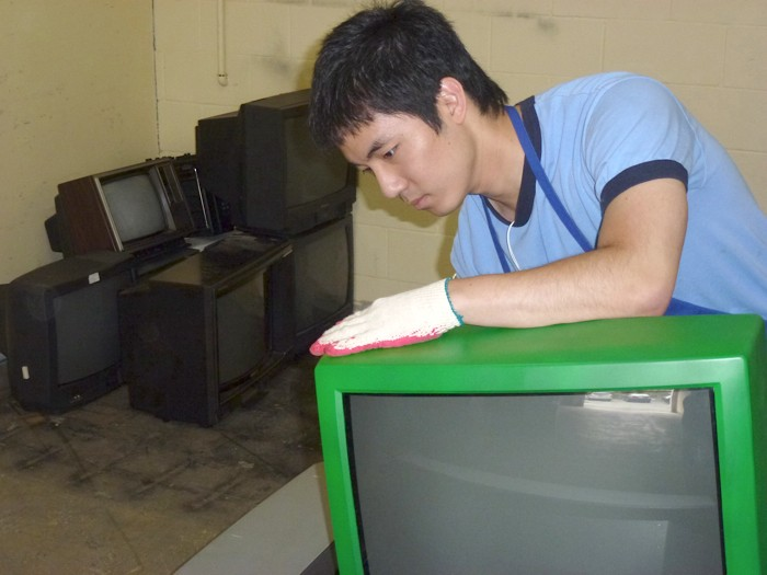 Assistant manager Johnny Ryu handles incoming TV sets at the Semiahmoo Bottle Depot in South Surrey.