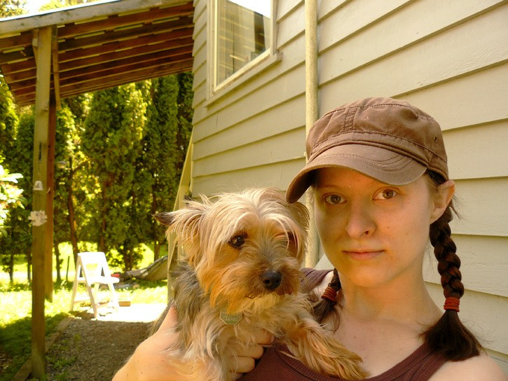 Rozlyn Kromhoff-Francis holds her dog Missy. After she was refused admission to celebrations at McLeod Athletic Park with Missy on Canada Day, the Langley resident wrote a letter of complaint that drew a quick response.