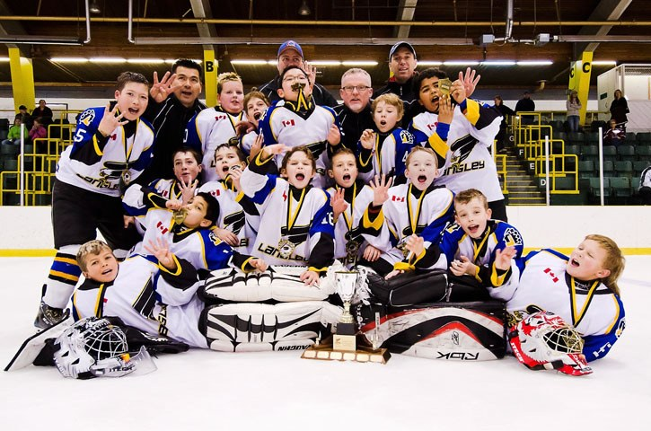 The Langley Hitmen celebrate after winning the atom Langley Cup with a 5-3 win over the Langley Blackhawks on Sunday at the George Preston Recreation Centre.