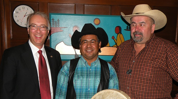 Aboriginal Relations Minister John Rustad (left) meets with Tsilhqot'in chiefs Roger William and Joe Alphonse (right) at his legislature office, October 2014.