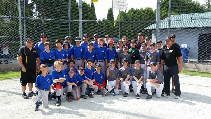 Members of the Langley Black Sox posed with their Victoria opponents following a doubleheader over the weekend at City Park. The Black Sox won both games, 7-6 and 9-2.