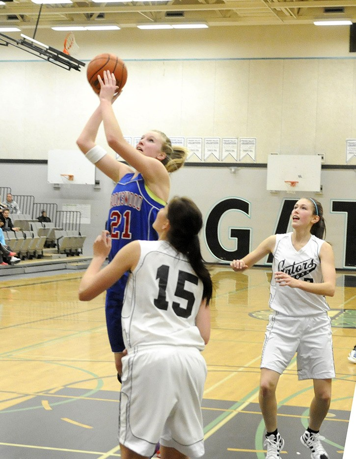 Brookswood's Tayla Jackson goes up for the shot while Dallas Tilley (#7) and Cassidy Irwin defend during Fraser Valley AAA senior girls league play last month. Brookswood has advanced to the Fraser Valley quarter-finals while Walnut Grove must win their next game to stay alive.