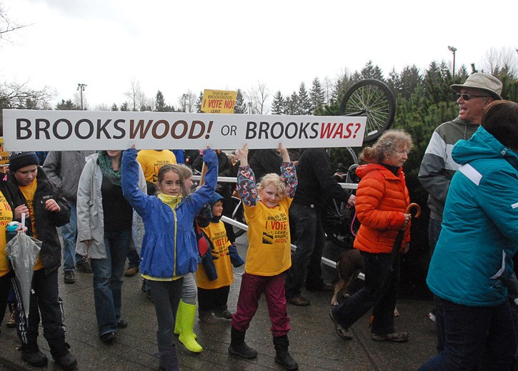 Aine Sunderland and Lily Aylen, both eight, carry a sign during Sunday's (March 30) march from Noel Booth Park to Brookswood Park in opposition of the new Brookswood/Fernridge Official Plan. More than 250 concerned residents turned out to speak out against the densification of Brookswood, on the eve of the Township vote to approve the controversial new plan.