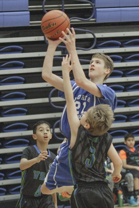 North Langley Lakers' Nathan Wright uses his size advantage to go up for the shot against Vancouver Sport Club Selects' Niam Zbitniff (#3) and Tyson Palma (#4) during the Lakers' 68-36 win on Sunday at the Langley Events Centre.