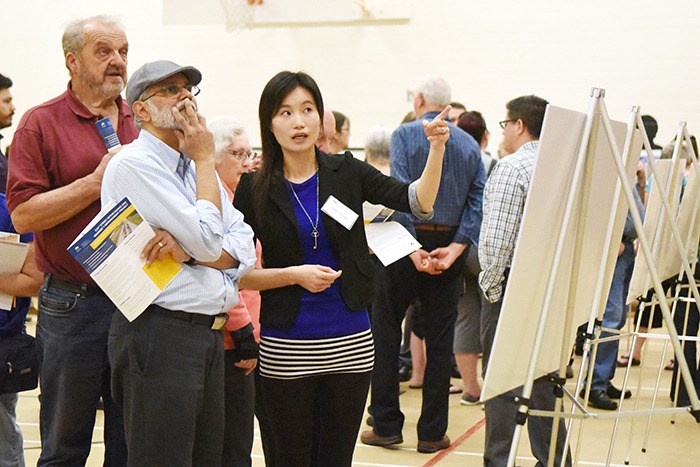 Helen Cheung was one of several project representatives at the 216 Street Interchange and Highway 1 Improvement Project open house answering questions from members of the public. The open house, held at Alex Hope Elementary on March 31, was the kick-off for the public consultation process. The project involves building a new interchange at 216 Street to access the freeway, and widening Highway 1 from 202 Street to 216 Street. Construction is set to begin this fall, with completion in the fall of 2019.