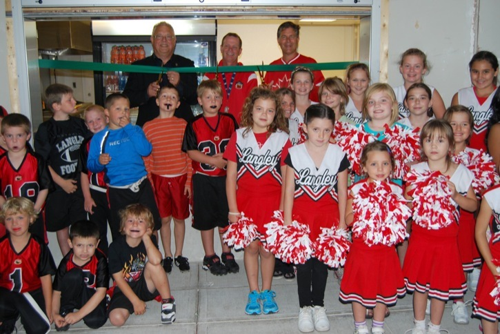 Township of Langley Mayor Rick Green, Langley Minor Football President Wayne McMurchy, and Langley MP Mark Warawa were joined by young athletes and cheerleaders who will make good use of new football facilities that were officially opened at McLeod Athletic Park on September 13.