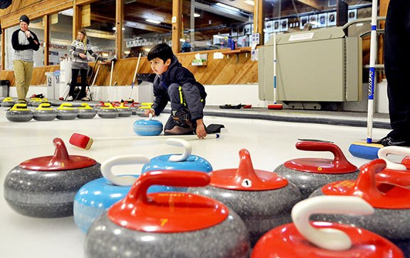 Ritvik Manikanda Prasath tried curling during the Langley Curling Club's open house on Saturday. The Learn To Curl event wraps up Sunday, running from noon to 4 p.m.