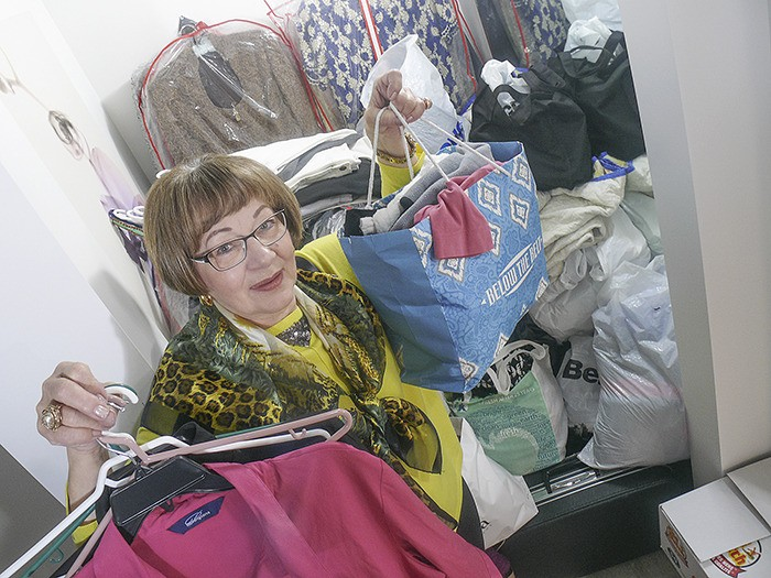 Delores Johns holds some of the more than 2,000 items of clothing donated so far to the Fort Langley Bagheera Boutique Makeover for a Cause  campaign. The boutique is collecting new and gently-used  clothing and other items for women in transition houses. Donations are being accepted at the Glover store until Nov. 9. when a draw will be held among donors for a $1,000 shopping certificate at the store.