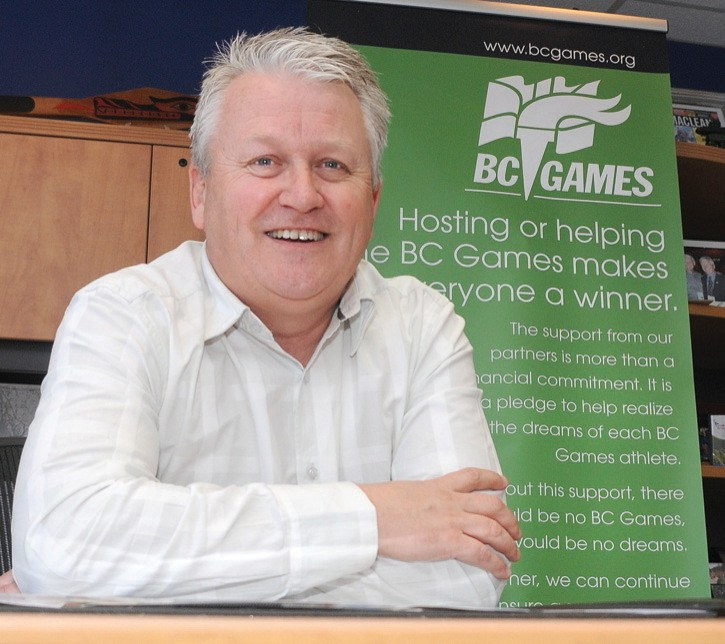 President and CEO of BC Games Kelly Mann sits at his desk in his office on the corner of Fort Street and Vancouver Street.