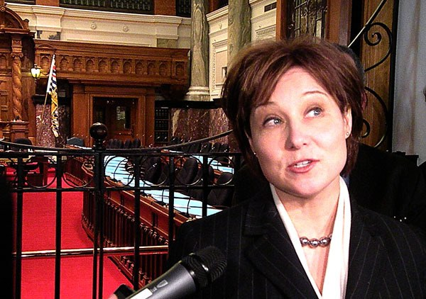 Premier-designate Christy Clark takes questions at the B.C. legislature Monday.