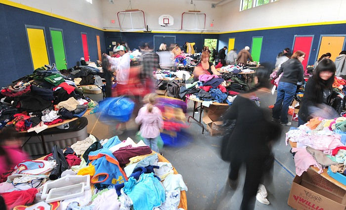 Visitors sift through free items at North Delta Evangelical Church during a Clothes2U event.