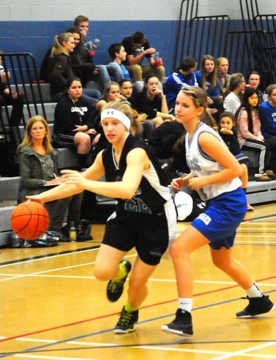 Walnut Grove Gators' Natalie Monro drives past the defence of Credo Christian Kodiaks' Jodi Bulthuis during Grade 8 girls basketball at Credo Christian on Jan. 29. The Gators enter this week's district championships as the top seed while the Kodiaks are fifth.