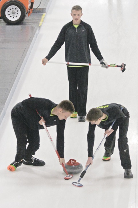 Scott Kryski watches his shot while Ty Karoway (left) and Ryan Scott sweep on Sunday. The Langley curlers compete in the Optimist Junior Interclub Div. 1 Curling League which plays out of the Langley Curling Club every second Sunday.