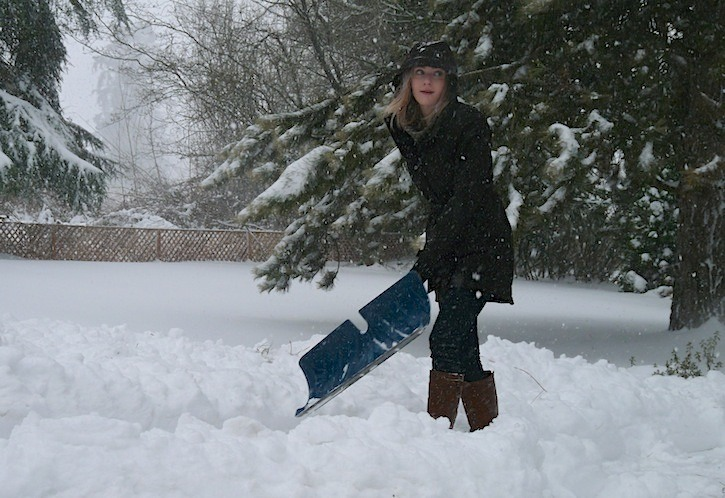 Callan Peacock was shoveling out her driveway on 240 Street as the heavy snow continued to fall Saturday morning.