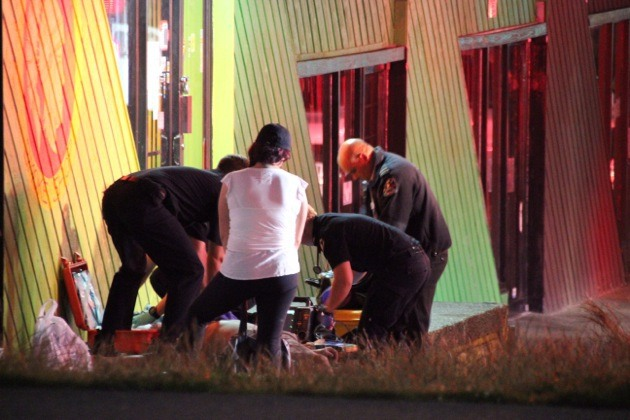First responders perform CPR on a drug overdose victim in Surrey Saturday night on 108 Avenue near 135A Street.