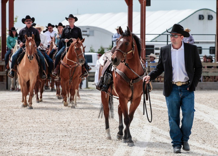 George Tidball Jr. leads a riderless horse with the stirrups turned backwards, as part of a tribute to his grandfather George Tidball at Sunday's service of remembrance, held at Thunderbird Show Park.