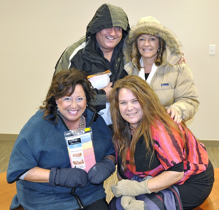 Langley realtors Clayton Lindberg, Karen Weber, Billie Semak and Michele Cartwright are participating in this year's blanket drive.