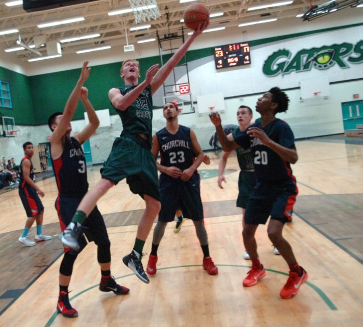 Walnut Grove's Jake Cowley goes up for the basket during the Gators' senior boys basketball exhibition game against Sir Winston Churchill last week (Dec. 29) at Walnut Grove Secondary. The Gators led early, but fell 79-68 to the Bulldogs. Walnut Grove sits at 9-2 on the season as they get set to tip off at the Legal Beagle Tournament this weekend in Port Coquitlam.