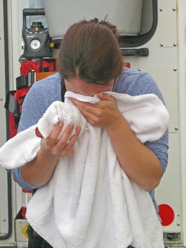 An undercover RCMP officer rinses her eyes after being attacked with pepper spray in Langley City last November.