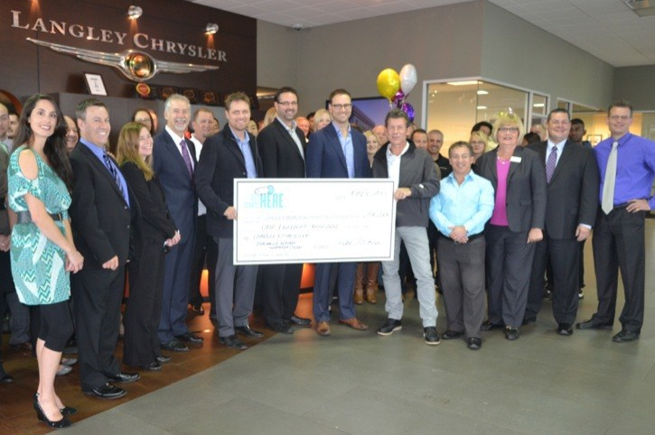 Langley Chrysler owners Mike, Mitch and Brad Trotman (centre) present a cheque for $100,000 to the Langley Memorial Hospital Foundation maternity ward campaign Tuesday. On hand to receive the cheque was foundation board member Mark Omelaniec and Dr. David Chapman.