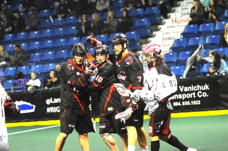 A common sight at Vancouver Stealth games: Joel McCready (left) and Tyler Digby congratulate Rhys Duch (#10) after another goal. Earlier this season, Duch set the Stealth franchise record for all-time points. And since entering the National Lacrosse League in 2009, only one player has more points than Duch in that time.