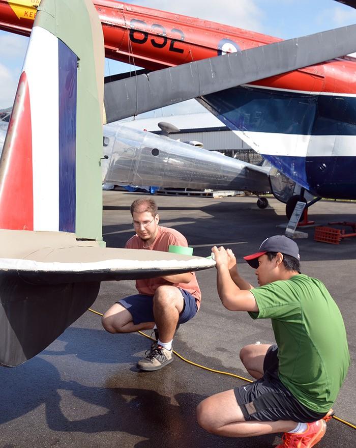 BCIT students Julius Hettig and Jason Kim paint a Handley Page Hampden, a Second World War aircraft, last month.