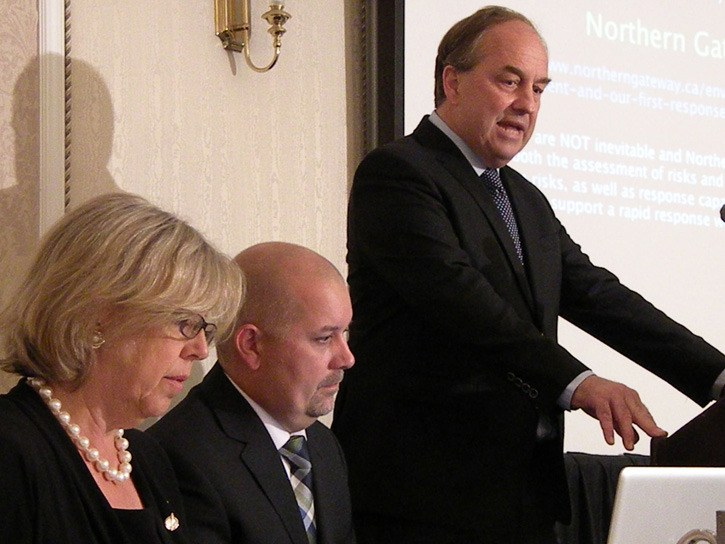 Federal Green Party leader Elizabeth May and provincial candidate Adam Olsen appear with B.C. party leader Andrew Weaver at a party event in Victoria, September 2013.