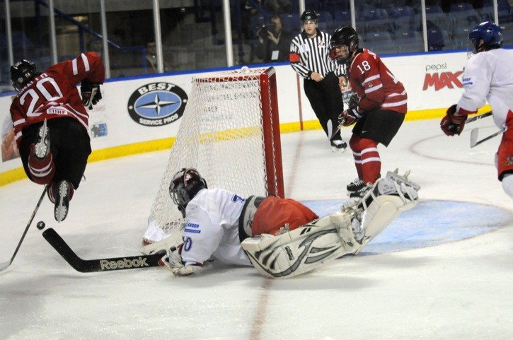 Czech Republic goaltender Marek Langhamer trips up Canada East forward Jeff DiNallo behind the net during the second period of the team's opening round game on Nov. 7 at the World Junior A Hockey Challenge at the Langley Events Centre. Canada East won 5-0 behind a hat trick from defenceman Randy Gazzola while goalie Adrian Ignagni posted the shutout.