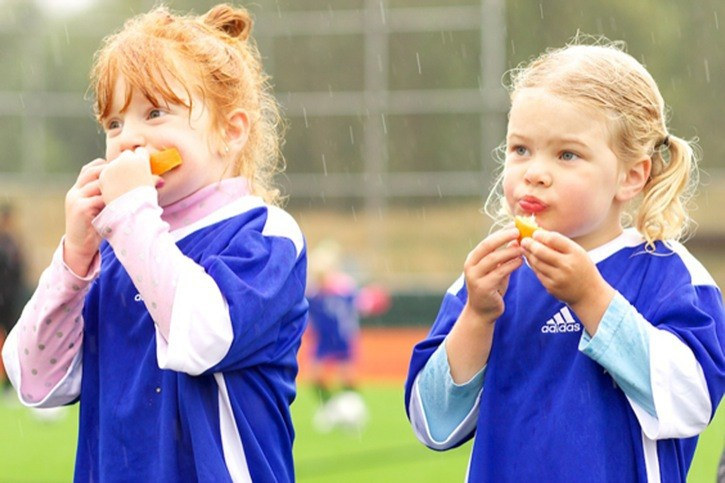 Hadley MacDonald (left) and Maddox Dickson enjoy some orange slices during a break in practice. The pair play for the Langley Dolphins of the Langley United Youth Soccer Association.