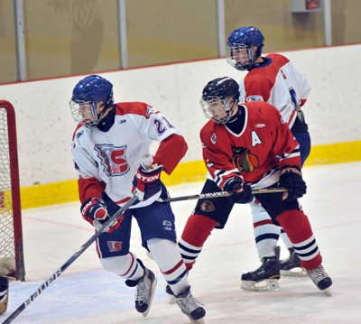 Langley's Kyle Burroughs (right) gives a subtle hook to Vancouver Northeast Chiefs' Truman Gonzales during major midget hockey action last week. In his first season at the major midget level, Burroughs is having a solid season. Last week, he played in the league all-star game. And next month, he will represent B.C. at the Canada Winter Games in Halifax.