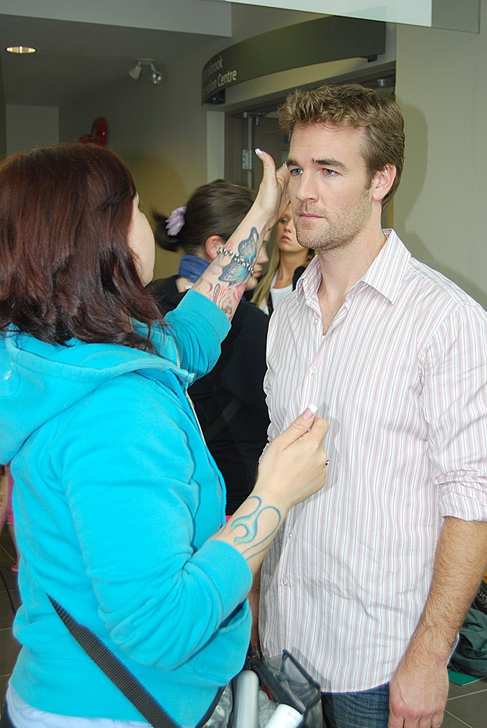 A makeup artist applies the finishing touches to James Van Der Beek prior to filming on location in Langley in 2009.