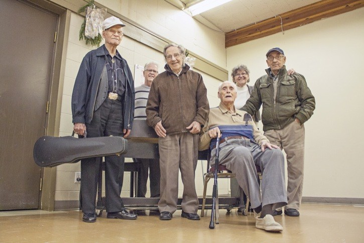 Some of the Merry Musicians stop for a photo after playing a concert at the St. Joseph's soup kitchen on Tuesday, Dec. 16. (L to R) Frank Towne, 91, Joe Sullivan, late 70s, Art Pettit, 97, former member Bill Lowe, 101, who came from, North Vancouver to perform, Georgina Talacko and Ronald Hergott, 81. Missing from the photo are Margaret Halcro, 97, and Hazel Copeland, 79.