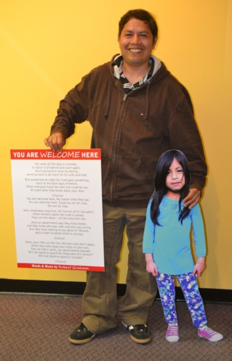 Jose Figueroa holds a cutout of his six-year-old daughter Ruby and a song a Toronto singer wrote about the Langley father's battle to stay in Canada. He faces deportation because of his non-violent involvement in a regime called the FMNL in his home country of El Salvador.