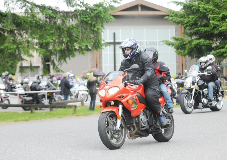 Cam Penner and his son Doug lead a convoy of 88 motorcyclists in the sixth annual Ride for Doug.