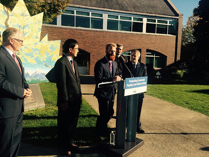 Maple Ridge Coun. Tyler Shymkiw, former chair of the Friends in Need Food Bank, speaks at the announcement in Maple Ridge on Wednesday about lowering borrowing rates for short-term cash loans.