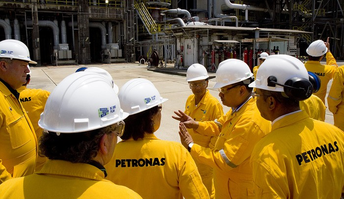 Natural Gas Minister Rich Coleman (left) and Premier Christy Clark tour PETRONAS natural gas import terminal in Malaysia in May.