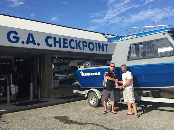 Legacy Water Search and Recovery Society member Jim Ward (left) with G.A. Checkpoint's Sean Elliot taking the keys for the society's new kingfisher boat purchased through donations, fundraising and gaming grants last month. The boat will be used to assist in finding drowning victims.