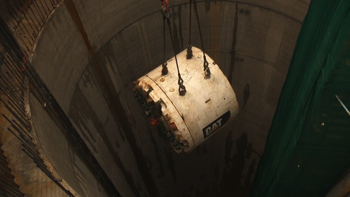 The tunnel boring machine 'Squirrel' being lowered into position during construction of a new water tunnel under the Fraser River.