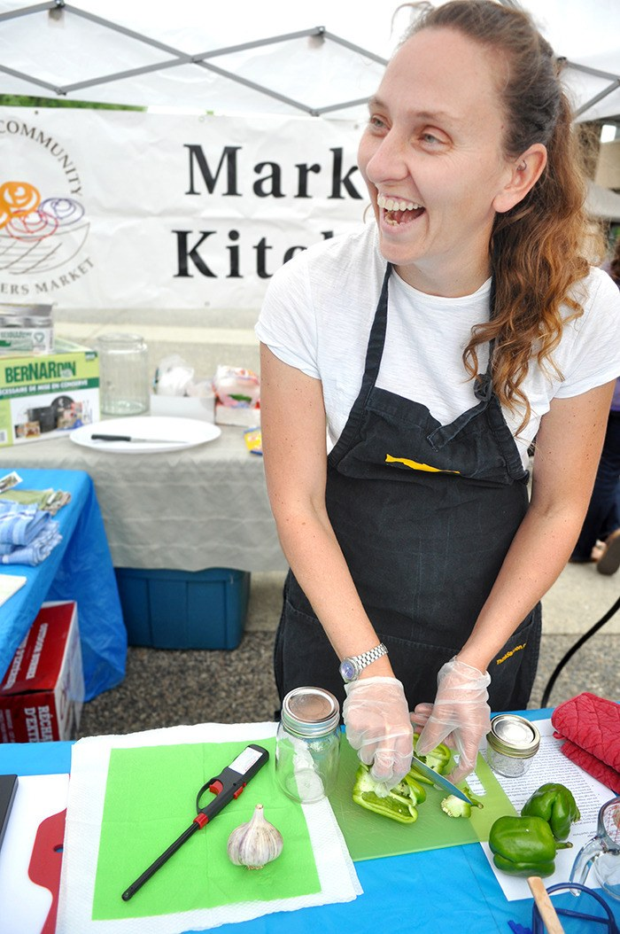 Lisa Dreves, stewardship coordinator at Langley Environmental Partners Society (LEPS), chops a pepper during a canning demonstration at the Langley Eats Local event last year.