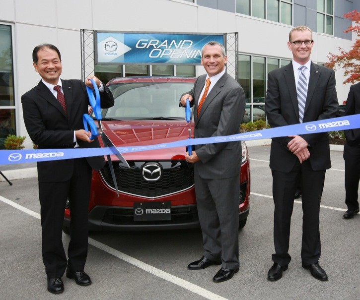 Kory Koreeda (left to right) president of Mazda Canada Inc., Neovia Logistics Services' Eric Cagle, and Scott Rasmussen, Mazda Canada's western regional manager, cut the ribbon to mark the official opening of Mazda new parts and distribution centre in Langley on Aug. 8.