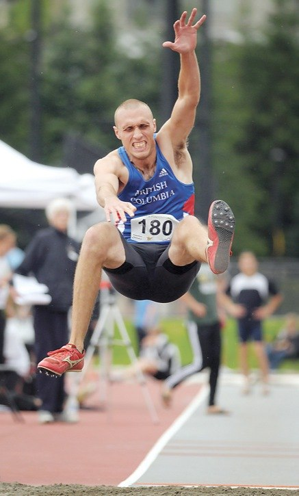 Langley Mustangs' Robert Gallaugher lands his long jump attempt at the B.C. provincial track and field championships held at Coquitlam's Percy Perry Stadium earlier this month. Gallaugher landed the gold medal in the senior (20+) men's division at the track and field meet.