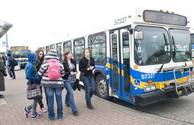Teens wait for the 501 bus to Surrey at the Langley City bus loop. A study done by the Township and City shows the need for a new transit exchange both in Langley City and at Willowbrook Shopping Centre.