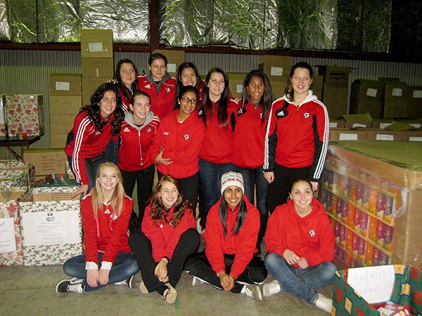 Youth sports teams like this group joined the army of volunteers helping out the Cloverdale Christmas Hamper Program last week.