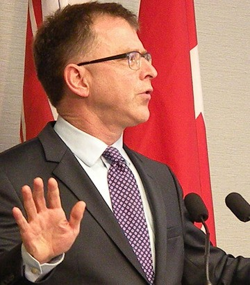 NDP leader Adrian Dix announces he will step down as leader by the middle of 2014 'at the latest.'
