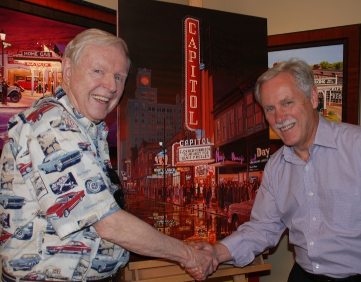 Veteran broadcaster Red Robinson and Langley artist Brian Croft are shown with Croft's latest painting of downtown Vancouver nightlife in the 1950s — a piece titled The Capitol Theatre Granville Street 1956 — which will be officially unveiled on Sept. 16 during the West is Best show at the home of Senator Gerry St. Germain.