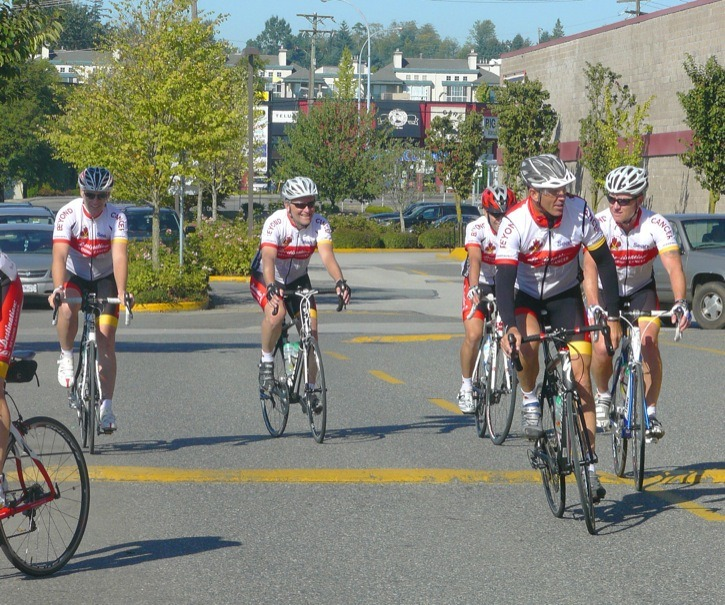 Members of the Sears National Kids for Cancer ride arrive at Willowbrook Shopping Centre on  Wednesday morning, after dodging rush hour traffic. The relay riders will cross Canada to raise funds to combat childhood cancers.