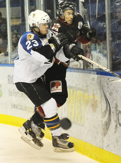 Langley Chief Josh Myers crashes Alberni Valley Bulldog Connor Farley into the boards during game 2 of BCHL playoffs Saturday night at the Langley Events Centre. The Chiefs won game one 5-4 in overtime and game two 3-1 to take a 2-0 series lead.