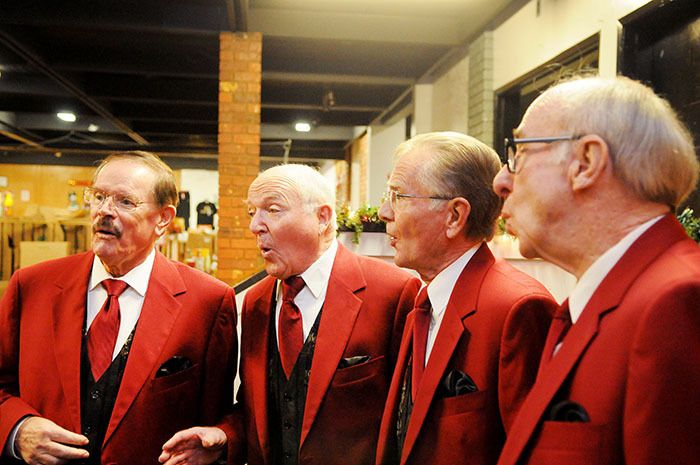First Capital Chorus' Synchromesh Quartert, including tenor Mike Wilcox, lead Gord Harris, bass Leigh Anderson, and baritone Bill Findlay sang at the Langley Christmas Bureau headquarters on Nov. 28, while dropping off a cheque for $1,361 for the bureau.